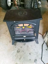 black and gray electric fireplace