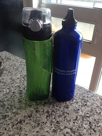 two blue and green sports bottles Toronto, M4G