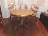 round brown wooden table with four chairs dining set Las Vegas, 89146