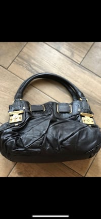 Juicy Couture Black Leather Purse with Gold Buckles. Never used Chino Hills, 91709