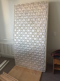 A firm and brand name mattress $95 +a set of metal frame for free Vancouver, V6B