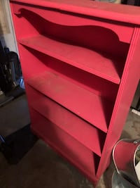 Bright pink bookcase About 4 feet tall