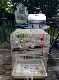 Bird cage one large 2 small  complete sets. Food dishes swings .
