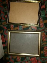 two brown photo frames