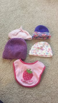 baby's assorted color knit cap and bib