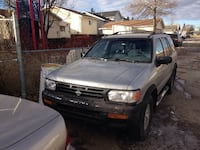 1998 Nissan Pathfinder 4wd runs drives perfecto decent body minor rust seen in pics truck is automatic has new tires done 6 mos ago first $1000 takes it!  Calgary