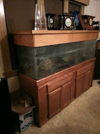 glass fish tank with brown wooden frame Minneapolis, 55409