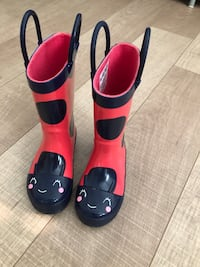 Pair of red-and-black rain boots Surrey, V3X 0B7