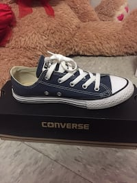 unpaired black and white Converse low tops with box Kansas City