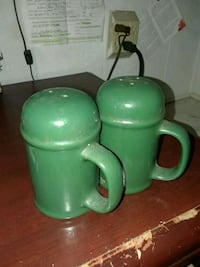 two green ceramic condiment shakers Port Richey, 34668