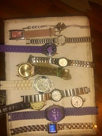 four assorted color analog watches Calgary, T2A 5W3