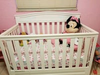 baby's white wooden crib