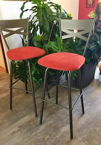 "Counter height, swivel bar stools. 2 available, each is $50. Base colour: Ebony Material: Microsuede  Colour; Burnt orange Swivels easily. Total height: 44"", height to seat 29"""