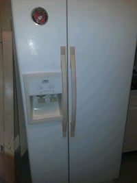 white side-by-side refrigerator with dispenser 358 mi