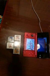 red Nintendo DS with game cartridges Chillum, 20782