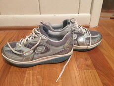 pair of gray Skechers running shoes