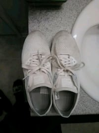 pair of white low top sneakers Lithonia, 30058