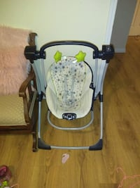 baby's white and black portable swing Newnan