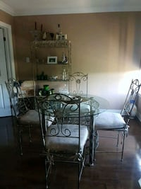 round gray metal framed clear glass table with four matching chairs dining set Toronto, M2R 3W8