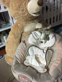 brown and white Fisher-Price cradle n swing