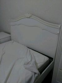 White bed and full mattress with 2 pretty knob dra Bakersfield, 93311