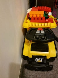 yellow and black Caterpillar dump truck toy Laval, H7N 5T8
