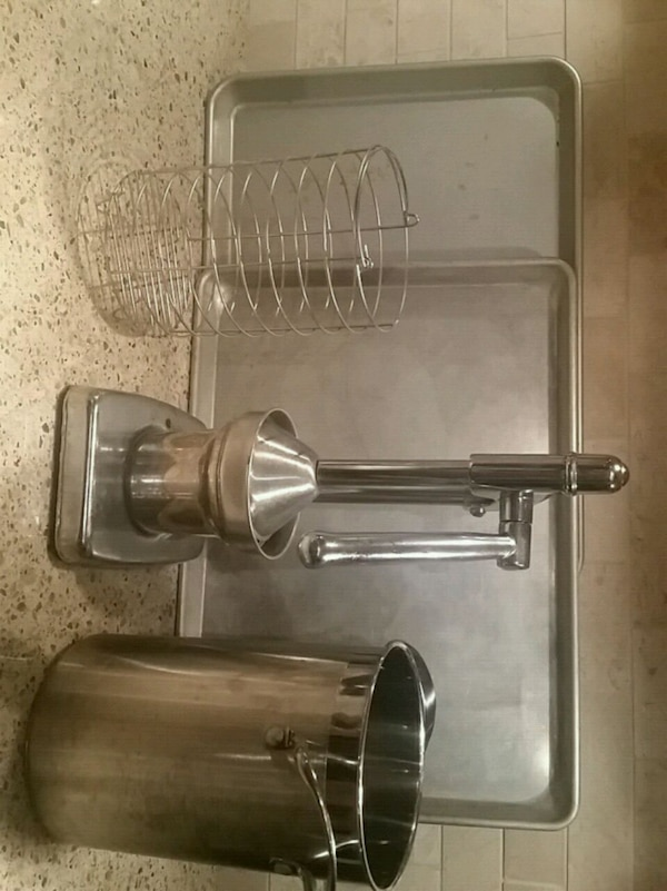 Juice press, two baking sheets, pot with cage