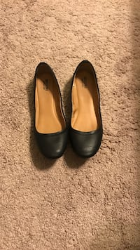 pair of black leather flats Simpsonville, 29680