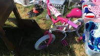 toddler's pink and white bicycle with training wheels Woodbridge, 22193