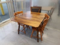rectangular brown wooden table with four chairs dining set Mount Rainier, 20782