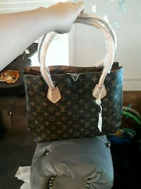brown and white Louis Vuitton leather tote bag Broken Arrow