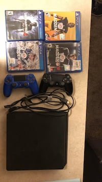 Sony PS4 console. 2 wireless controllers. 4 games.  Denver, 80203