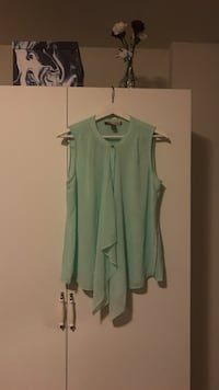 Light green sleeveless blouse