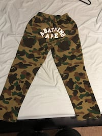 black, brown, and green camouflage pants New York, 10468