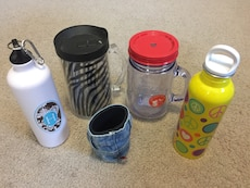 Assortment of various water bottle assortment and blue jean cookie