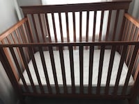 Baby's brown wooden crib Raleigh, 27604