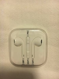 white Apple EarPods with case