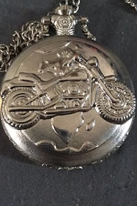 Silver cruiser motorcycle engraved pocket watch.