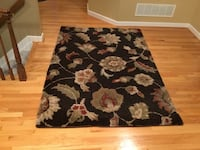 Multicolored print with black background area rug. Columbia, 21044