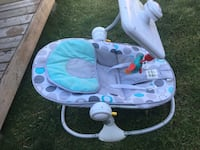 baby's blue and white bouncer Calgary, T2J 0T4