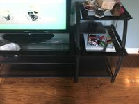 black wooden TV stand with flat screen television Toronto, M9W 4M1