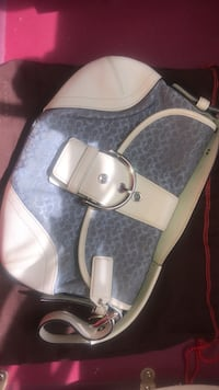 gray and white monogrammed Michael Kors leather tote bag