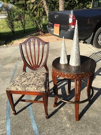 Antique chair paired with side table .
