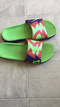 Pair of green-red-and-purple nike kd slide sandals Edmonton, T5T 2T2