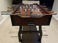 brown and black wooden foosball table Saint Catharines, L2P 0A8