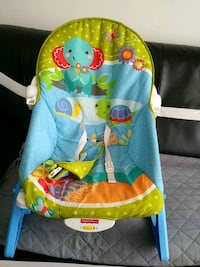 baby's blue and green Fisher-Price bouncer Calgary, T3J 3G5