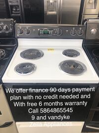 like new black and white electric stove coil top Ge self cleaning Warren, 48089