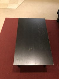 rectangular black wooden coffee table Herndon