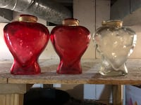 Two red ceramic candle holders 15 km