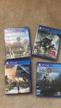 three assorted PS4 game cases Arlington, 22202